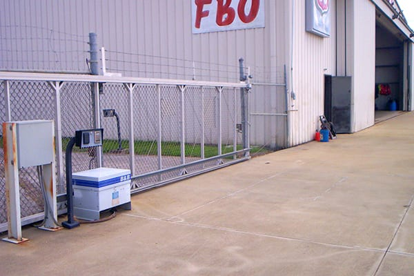 black chain link commercial fence with privacy slats